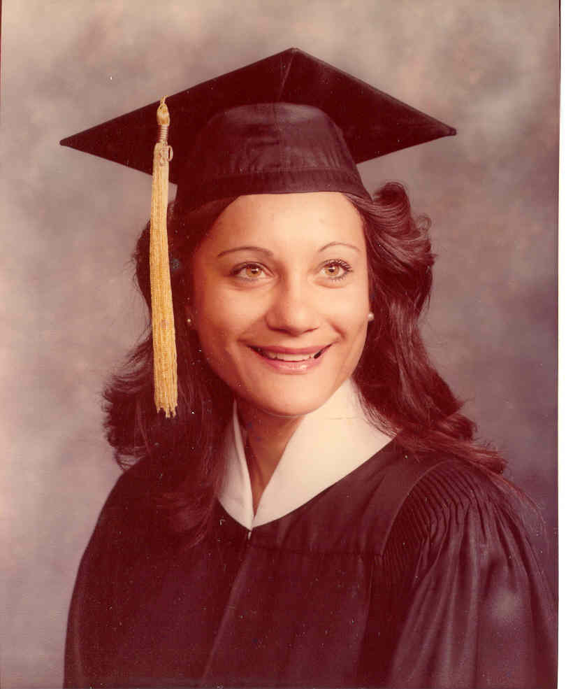 Picture of Ms. Revoir in her cap and gown when she graduated from Brigham Young University